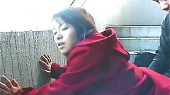 Cute Chinese providing a hot outdoor blowjob
